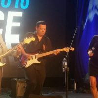 Alan Berg CSP playing guitar at the NSA Convention